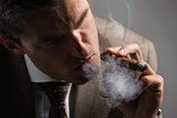 Elegant businessman smoking a cuba cigar