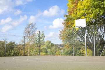 Empty Basketball Court in Autumn
