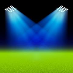 Bright spotlights illuminated green field stadium