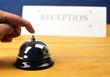 Customer Hand on Hotel Reception