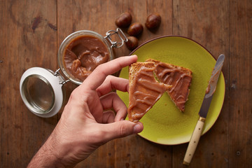 Hand holding a toast with chestnut cream