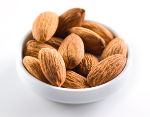 Almond. Heap of nuts isolated on white background