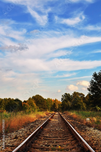 Picturesque autumn rural landscape with railway track.