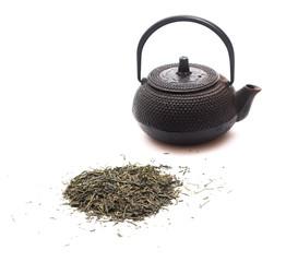 Green tea and a black japanese teapot