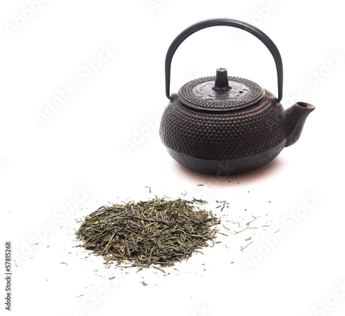 Green tea and a black japanese teapot