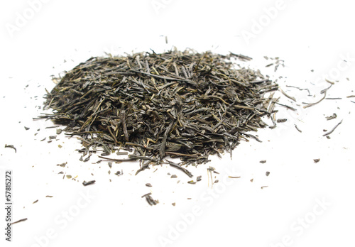 Photo of green bulk tea on a white background