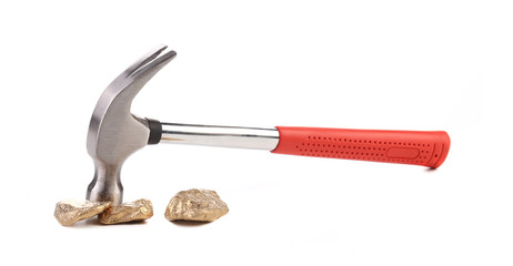Close up of gold nugget and hammer.