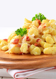 Small potato dumplings with bacon and cabbage