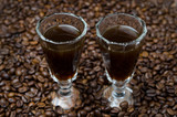 two shot glasses of coffee liqueur, selective focus horizontal
