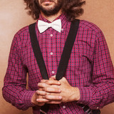 Hipster guy 's clothes in a plaid shirt and bow tie