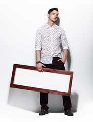 Fashion Man holding Board with White Blank Space for Text