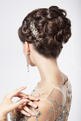 Refinement. Sophistication. Stylish Woman with Festive Coiffure