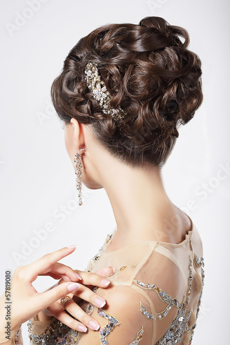 Refinement. Sophistication. Stylish Woman with Festive Coiffure Plakat