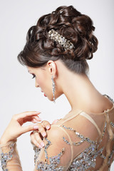Elegance. Chic. Beautiful Brunette with Classy Hairstyle. Luxury