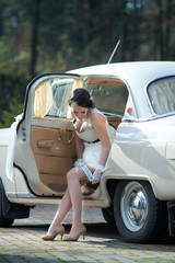 bride in white wedding car