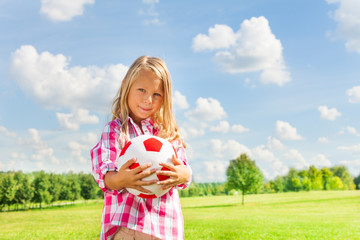 Blond girl with ball