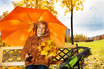 Blond girl under umbrella