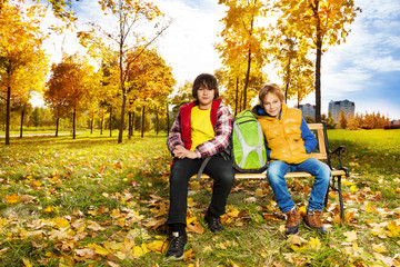 Two boys in autumn park