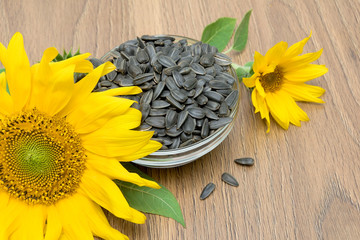 sunflowers and ripe seeds close-up on a wooden board