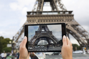 Woman in Paris taking pictures, Eiffel Tower, Tablet PC