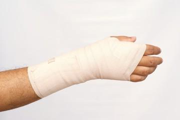 medicine bandage on injury hand on white background