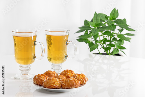 Tea in glass cups and tasty cookies
