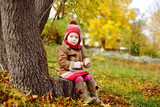 toddler girl in fall time