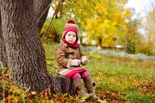 toddler girl in fall time