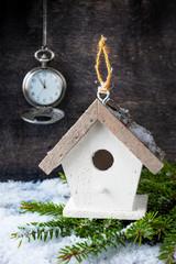 Сhristmas tree decoration, antique clock and birdhouse