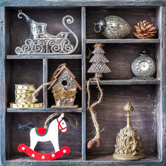 Antique clocks, bell, rocking horse, Santa's sleigh. Collage.
