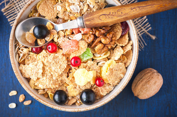 Close-up of muesli (granola) with berries, walnuts and milk