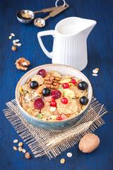 Muesli (granola) with berries, walnuts and milk