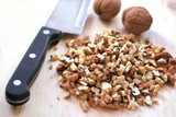 Chopped walnuts on wooden background