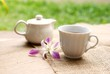 cup of tea with orchid flower on wooden table