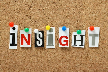 The word Insight on a cork notice board