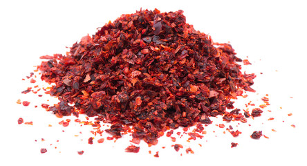Heap of red pepper flakes isolated on white background