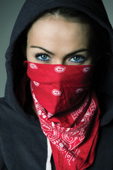 girl hood and red scarf covered face