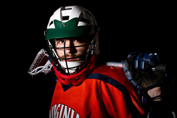 Lacrosse player, studio shoot on the black background
