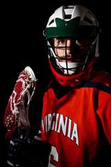 Lacrosse player, studio shoot on the black background
