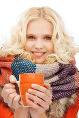 teenage girl with tea or coffee mug