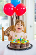 Girl With Mouth Open Sitting In Front Of Cake