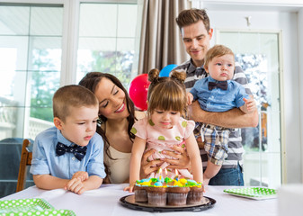 Family Celebrating Girl's Birthday