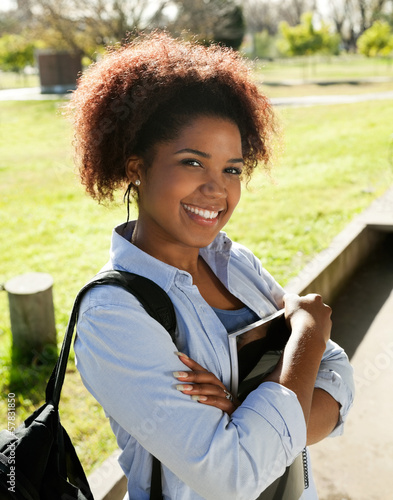 Woman Standing Arms Crossed On College Campus