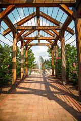 Brick Walkway Through Rose Arbor Toward Fountain
