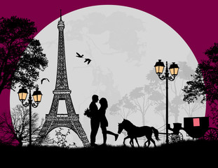 Carriage and lovers at night in Paris