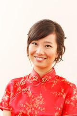 Chinese girl in traditional Chinese cheongsam