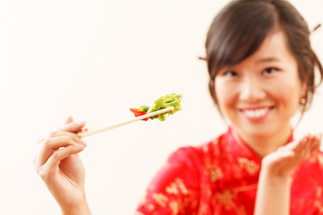 chinese woman with chopsticks