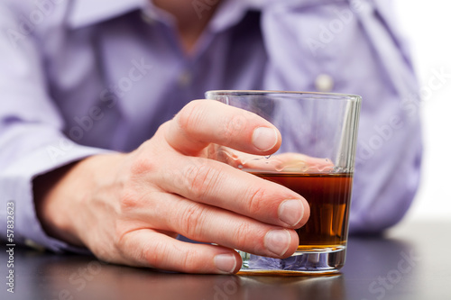 Businessman with glass of whisky