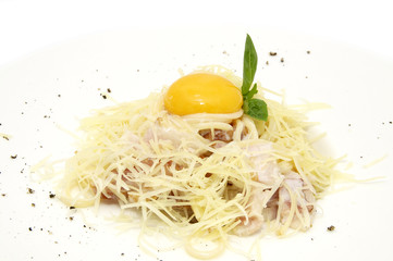 spaghetti with egg on a plate closeup