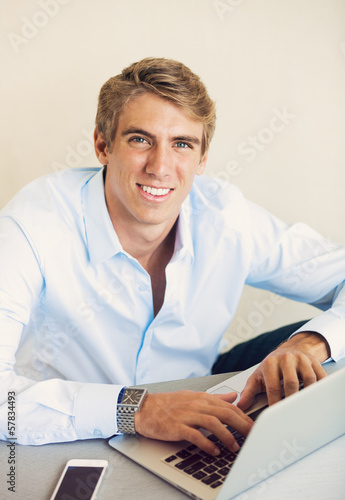 Professional Young Man Working on Laptop Computer